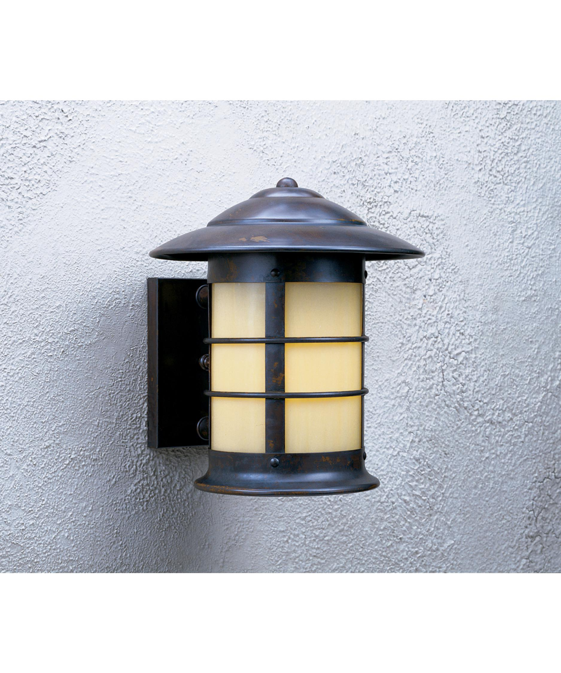 shown in bronze finish and tan glass arroyo craftsman lighting